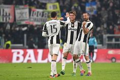 Andrea Barzagli, Daniele Rugani (C) and Giorgio Chiellini of Juventus FC celebrate victory at the end of the Serie A match between Juventus FC and AS Roma at Juventus Stadium on December 17, 2016 in Turin, Italy.