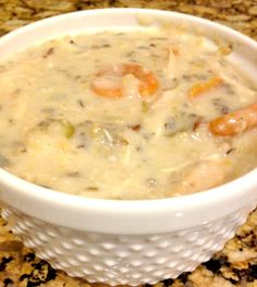 Skinny (but hearty!!) Creamy Chicken & Wild Rice Soup…Crockpot Style...I added mushrooms and subbed out plain greek yogurt for the heavy cream and coconut oil in place of butter. :D