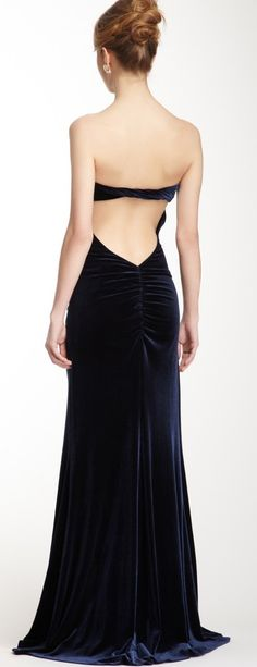This velvet gown reminds me of my grandmother's wedding dress--midnight blue velvet with a trumpet skirt and a peek of back...