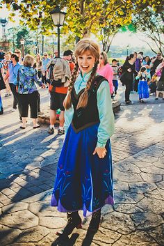Disney Frozen Anna face character... its funny how nobody is coming up to her... if I was there I would run up to her and talk to her for hours if I could!