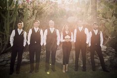 Mixed-gender wedding parties (or bridal parties) are a huge wedding trend this year! These groomsmen (and one groomswoman) rock tailored vests and pants. {Matthew David}