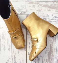 A cool twist on the black ankle boot, these striking gold shoes feature fringe detail and a manageable mid heel. Wear with tailored trousers for a smart yet on-trend look.