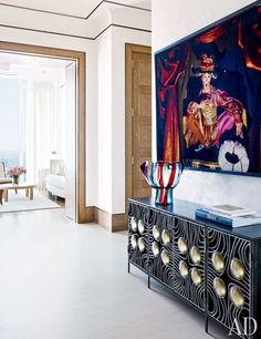 In this modern penthouse in Manhattan, a Cindy Sherman photograph from 1993 hangs above an iron-and-glass cabinet.