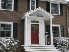 dark brown siding with white trim and red door