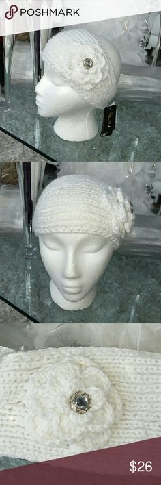 Brand new Lovely knitted headwrap Brand new with tags  Grab this lovely white hand knitted head wrap featuring a knitted flower and button detail. Button in the back.100% polyester   one size fits most. 2 brown buttons for length/adjustment option. Accessories
