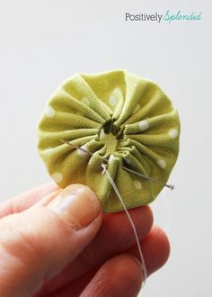 Fabric yo-yo's are a great way to use fabric scraps! Free templates with tutorial at Positively Splendid. Fabric yo-yo's are a great way to use fabric scraps! Free templates with tutorial at Positively Splendid. Sewing Hacks, Sewing Tutorials, Sewing Projects, Sewing Tips, Diy Projects, Sewing Ideas, Techniques Couture, Sewing Techniques, Sewing Patterns Free