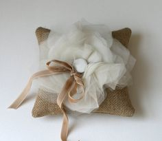 Hard and soft combined to make a beautiful ring pillow.
