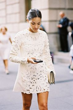 Laser-cut lace mini dress outside the shows during New York Fashion Week.