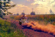 Dust - Ruse district, Bulgaria - July 21, 2017. Ivanovo village area, Ruse region, Bulgaria, ATV in action