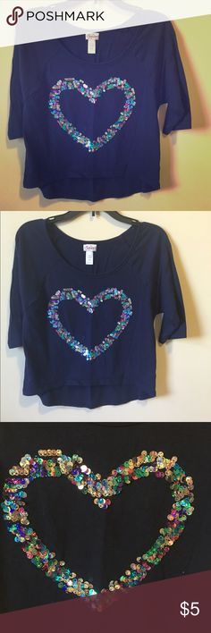 Justice Sequin Heart Top Awesome navy top with 3/4 sleeves and a multicolor sequin heart. In excellent condition and from a smoke free home. I'm having a huge sale on kids clothes, so check out my closet and the kids sale listing for directions on how to get 40% off bundles of 2+. Justice Shirts & Tops Blouses