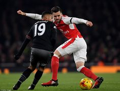 Sofiane Boufal (left) of Southampton runs at Arsenal defender Carl Jenkinson during the first half of Wednesday's cup clash