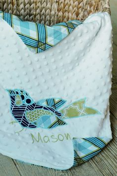 Baby Blanket tutorial with applique & name....print out name/font you like, trace onto minky fabric then hand sew with floss....so cute & easy!