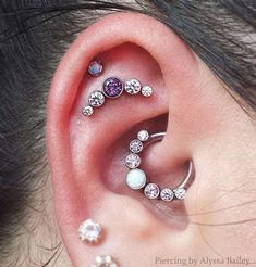 Dayna loves her bling! She stopped by @ironlotusbodyart and @alyssarbee added this new Violac Topaz/Lavendar/Clear gemmed cluster to her flat. This cluster features two thread points to prevent the jewelry from twisting and turning. Daith/helix/lobe piercings were not done by @alyssarbee.