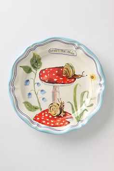 Francophile Dinner Plate, Mushroom #anthropologie  May your meals never be without a touch of Parisian whimsy. Depicting both the traditional and the kooky, these charming plates are Anthropologie exclusives from French designer Nathalie Lete.