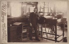 Two_Men_at_Slant_Top_Desk_H_A_Mowrey_Ashland_O_c._1892.jpg (842×540)
