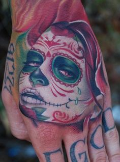 A collection of some of the coolest looking hand tattoos.