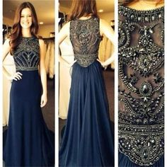 The navy prom dress is fully lined, 4 bones in the bodice, chest pad in the…