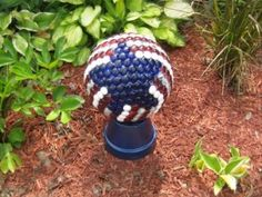 red, white and blue bowling ball will created a sensatiion