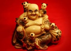 Porcelain Laughing Buddha with five children, brings good fortune from heaven, greatly increasing chi.