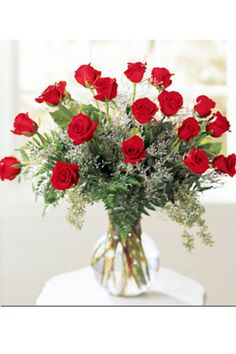 Eighteen gorgeous long stemmed roses elegantly arranged with fresh foliage and accent blossoms in a glass vase.      #roses #love #anniversary #wedding #kiss #wife #girlfriend Roses For Her, Wedding Kiss, Blossoms, Glass Vase, Anniversary, Fresh, Table Decorations, Home Decor, Flowers
