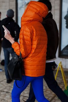 i have an orange TNF thin puff jacket. i always thought it was TOO orange. after seeing this post from NYFW via the sartorialist, i guess i can wear it proudly now :)