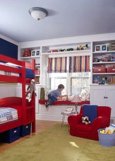 This is one of those bedrooms with a reading nook that I think is so important for children (if you have room).  The window seat provides a comfortable place to read and it's a great light source.  The bookcases are a must to inspire reading.  When possible, add a chair so mom or dad can have a place to sit while reading the bedtime story...... Love it