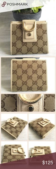 """Gucci Abbey French Wallet Authentic Gucci Abbey French Wallet.  Measures about 5"""" W x 4.25"""" H.  Monogram canvas and leather details, snap closure, 4 card slots, coin compartment with a snap closure.  Serial number 141421.1408.  Made in Italy.  In very good condition.  Light rubbing wear on leather corners.  No trades. Gucci Bags Wallets"""
