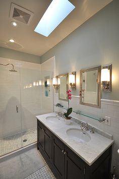 walk-in shower with rain shower head and double vanities
