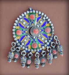 """Old silver enameled Kabyle """" Tabzimt """"or fibula from Grande Kabylie, in Algeria. 