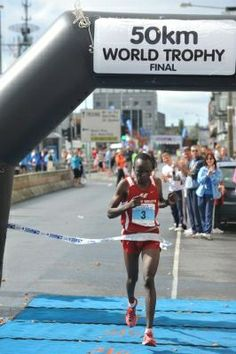 Collen Makaza, World Champion 2010 (Galway) and Multi Record Holder going for record win at Two Oceans Marathon 2014 Record Holder, Marathon Running, Oceans, Athletes, Finals, Champion, Basketball Court, World, The World