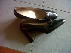 Ferragamo black leather high heel with golden logo