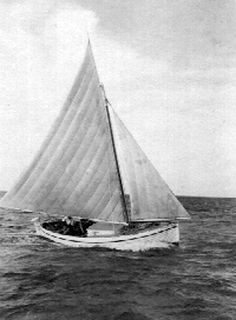 """Joe Young's sailboat """"Linton."""" This is originally a ship's lifeboat washed up on the reef during WWII. Joe found it, fixed it up, rigged it with mast, sails and cabin. It became a very popular """"for hire boat"""" in the 40's, largely because of Joes's great personality. Belize"""