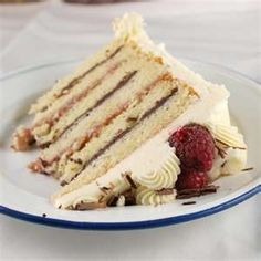 White cake with white chocolate buttercream frosting and raspberry curd and chocolate ganache fillings