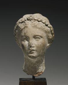 A Hellenistic Terracotta Head of a Woman, circa 3rd Century B.C.