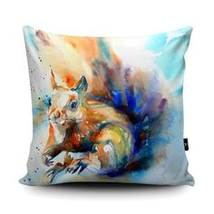Formby Red Squirrel by Liz Chaderton. Faux Suede Cushion.  Stand out from the crowd with our Wraptious cushions, made with super soft Vegan Suede - the sort of velvety material that makes you go oooh when you touch it! Choose from two sizes: 45x45cm (18 inches) 60x60cm (23.6 inches)  Just the right size to snuggle to on the sofa, and fully machine washable at 30oC. Vegan and eco-friendly. Handmade in the UK with a choice of coloured backings and hidden zip. Comes complete with a choice of…