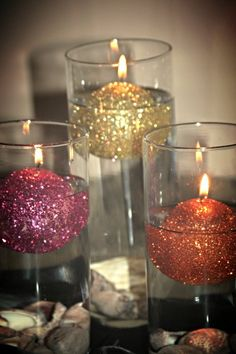 Glitter-covered floating candles for wedding centerpieces