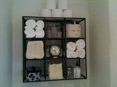 With very limited storage above the toilet , this wire cube storage idea makes functional display. http://hative.com/over-the-toilet-storage-ideas-for-extra-space/