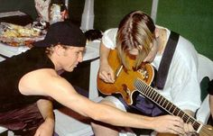 Frick Showing Frack to Play Guitar