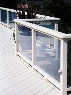 See-Through Railings.  My next deck will have this with dark trim