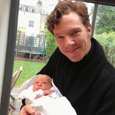 Benedict Cumberbatch with a baby
