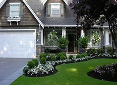 The garden and the lawn look so nice in the front! Would live to make the front of our house look like this