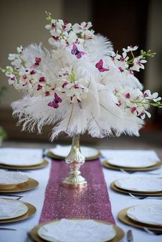 Quinceanera Centerpiece Ideas. Afloral.com has high-quality faux flowers, feathers and decorations for your event.