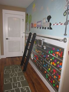 This is an amazing idea - for a playroom or basement maybe? I won't do a train theme, but you could do whatever you want, really. And its relatively cheap for the magnitude of the project you're tackling, I think. LOVE it. Can't wait to get into a house and do this one.