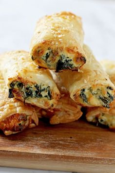 Spinach and Ricotta Rolls are great for entertaining or for easy snacks. Made with flaky puff pastry, these vegetarian cheesy rolls are quick to prepare and freeze well. A hit with kids and adults alike. Lunch Snacks, Savory Snacks, Savoury Dishes, Easy Snacks, Kids Party Snacks, Lunches, Puff Pastry Recipes Savory, Spinach Puff Pastry, Spinach Puffs Recipe