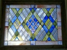 Idea for laundry room cabinet doors - Faux stained glass window I made with a piece of plexiglass