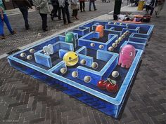 This incredible 3D Pac-Man street painting was created on the sidewalk in Venlo, The Netherlands by Leon Keer of Streetpainting 3D. You may remember he was also involved with creating the LEGO Terracotta Street Army at the Sarasota Chalk Festival.
