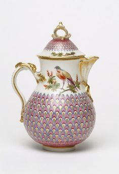 Painted pot and cover with peacock pattern, 1740-1770.  The porcelain factory at Chelsea was managed by Nicholas Sprimont, a Hugenot silversmith. He continued to make silver after starting his porcelain business, and many pieces of early Chelsea are influenced by silver shapes. The location of his factory was conveniently close to the pleasure gardens at Ranelagh, patronised by royalty and the aristocracy. The factory specialised in figures, vases, and fine enamalled tablewares.