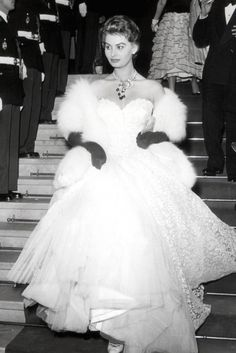 SOPHIA LOREN  Sophia Loren was the epitome of Hollywood glamour at the Cannes Film Festival in 1955 in this show-stopping ball gown teamed with a fur shawl, long gloves and statement jewels. (1955)