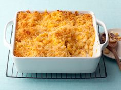 Baked Macaroni and Cheese  Alton's baked macaroni and cheese is as creamy, cheesy and rich as the next, but he adds mustard powder and paprika for a little heat. Topped off with panko breadcrumbs that crisp up in the oven, this casserole-style delight won't last long on any buffet spread.