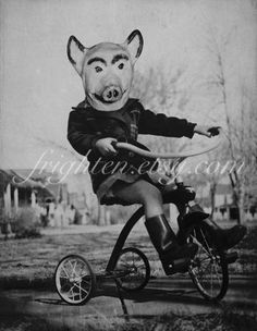 Black and White Halloween Art, Mixed Media Collage Print, Piggy, Girl on Tricycle with Pig Mask, Halloween Decoration.  via Etsy.